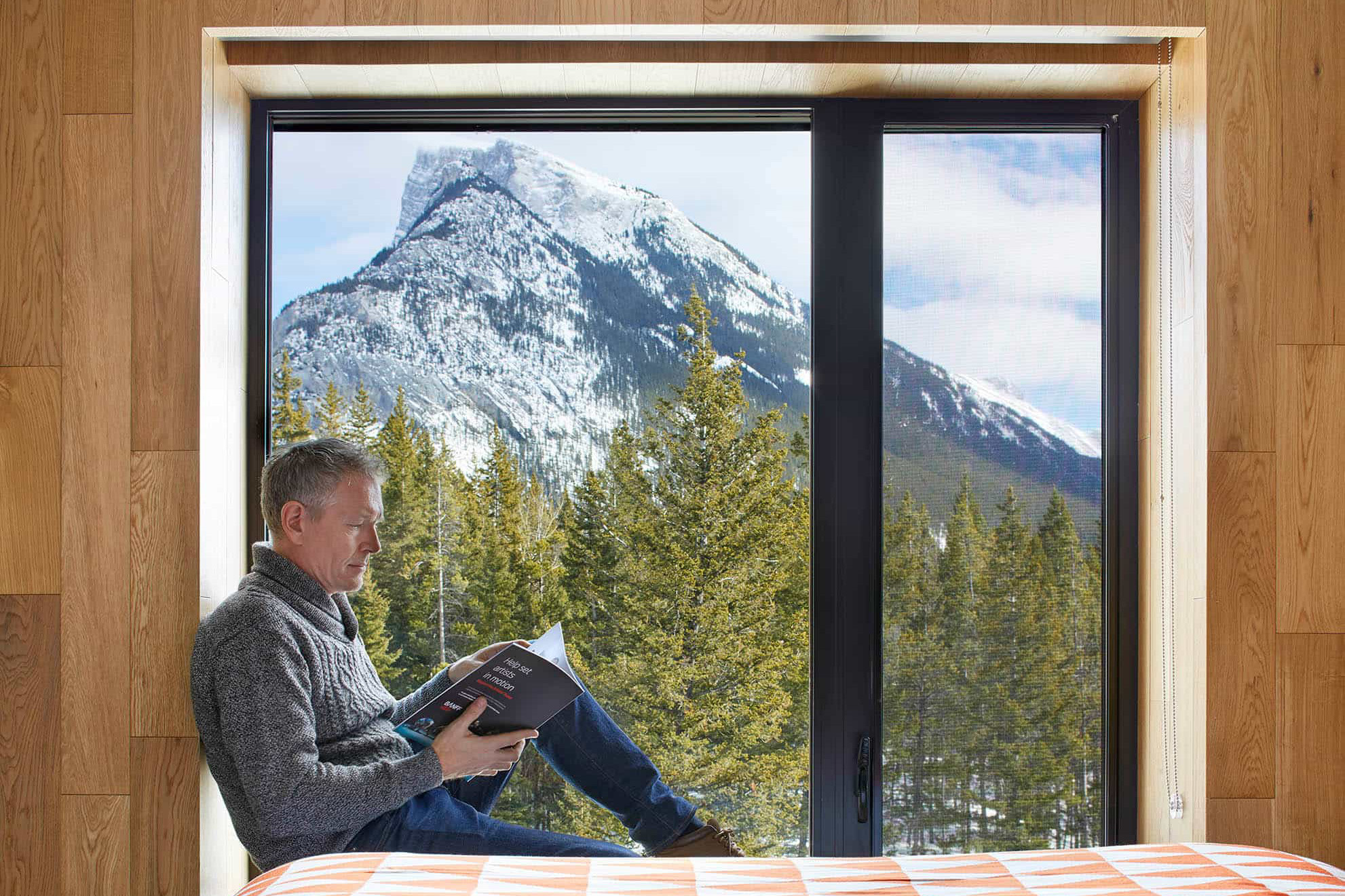 A man enjoying the view from his hotel room at Lloyd Hall Hotel