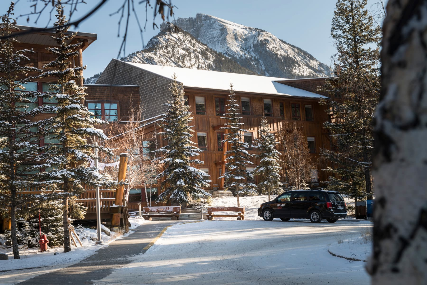 PDC Hotel at Banff Centre with a backdrop of snow-capped mountains.