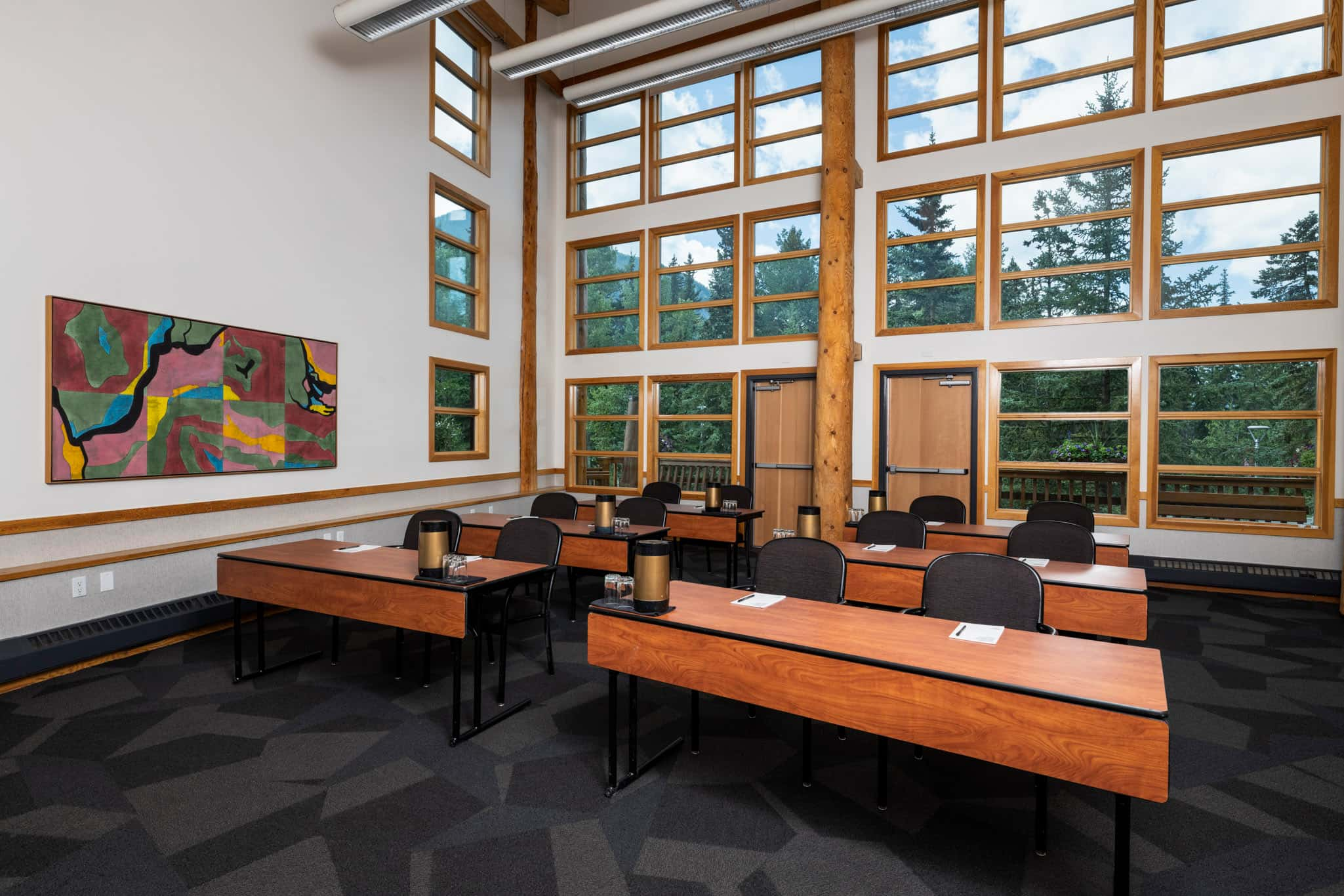 Bright meeting room with full sized windows in the back of the room.