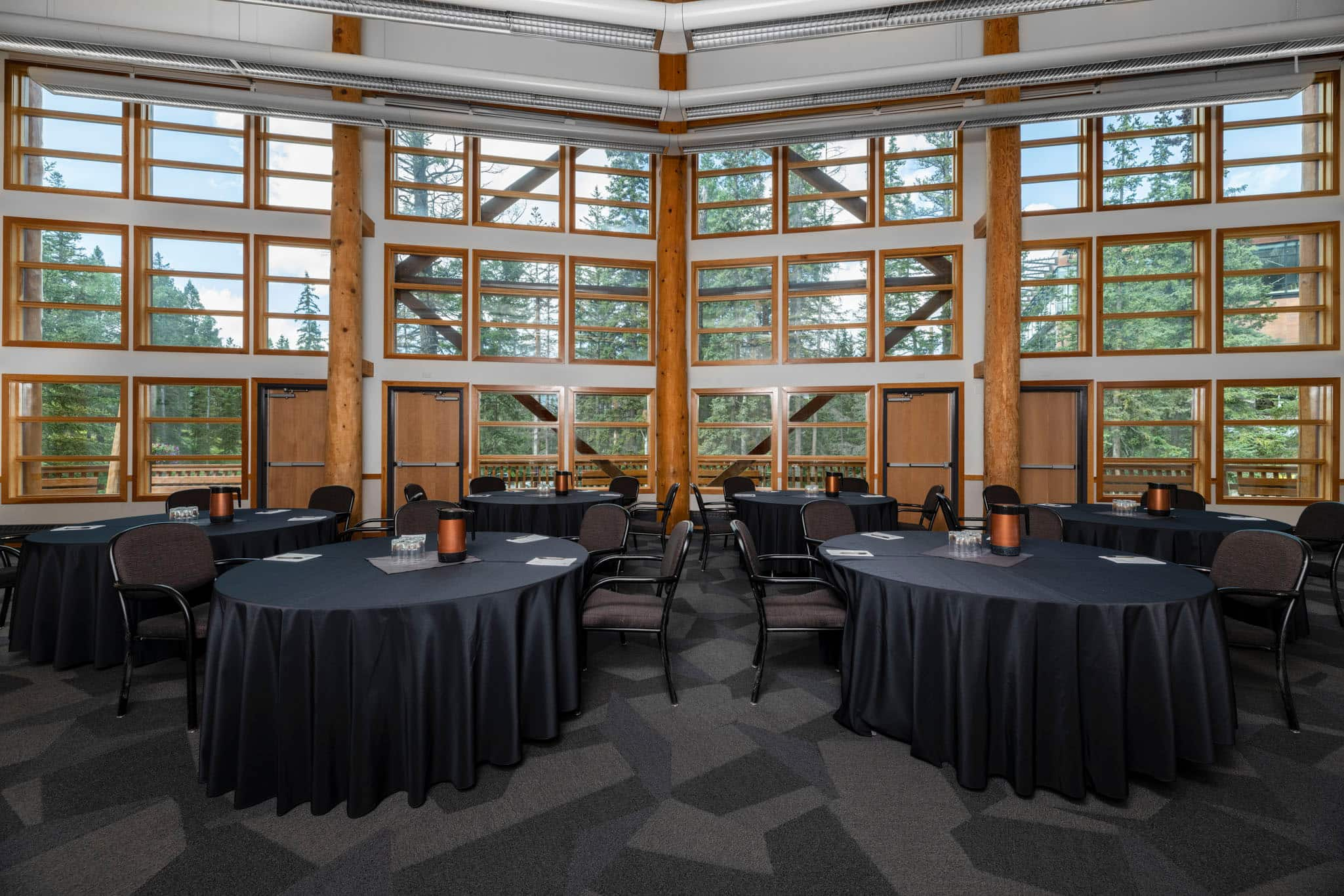 Banquet room with tables in the Professional Development Centre Hotel.
