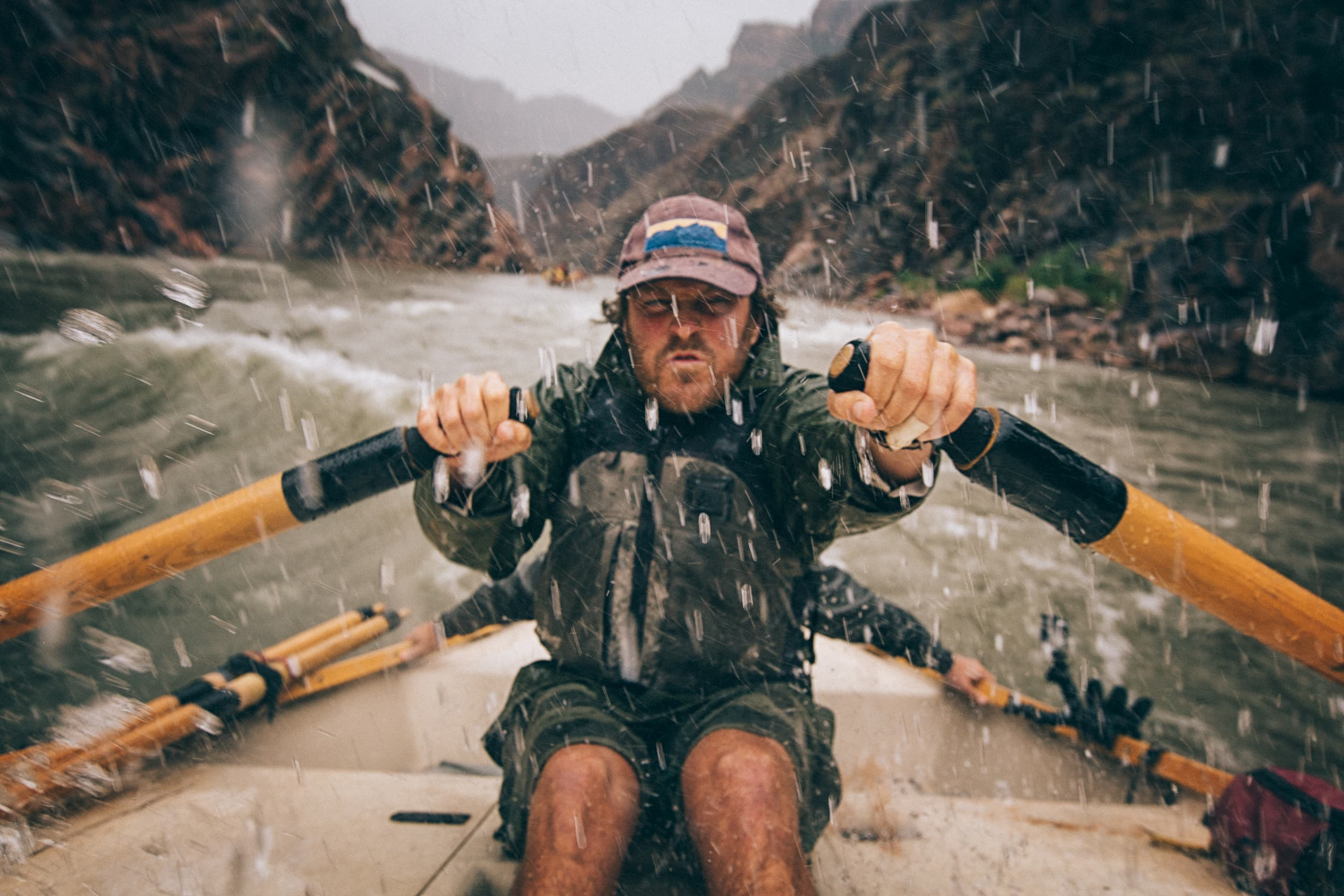 Man rowing in extreme conditions