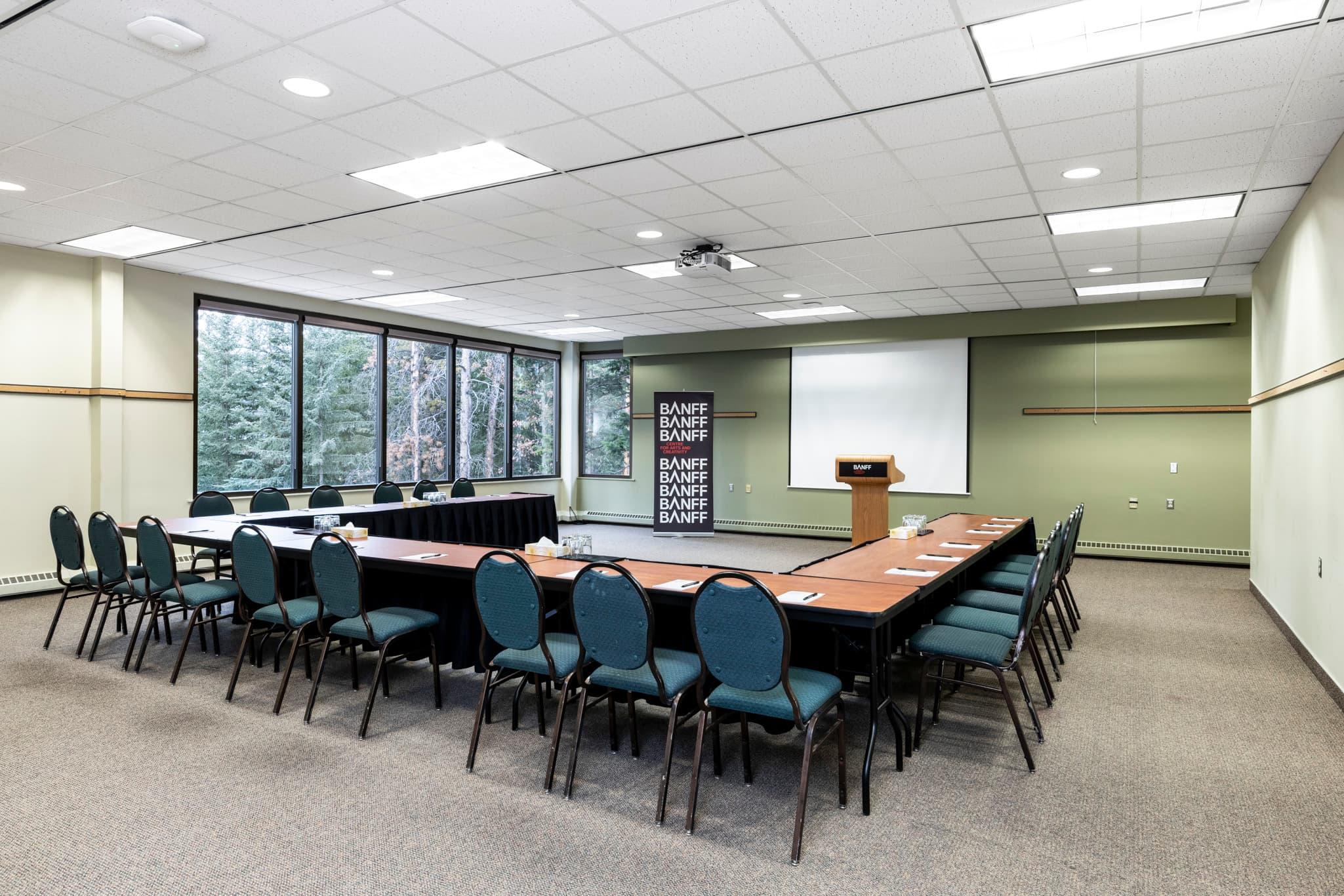 A conference rooms with a U-shape setup