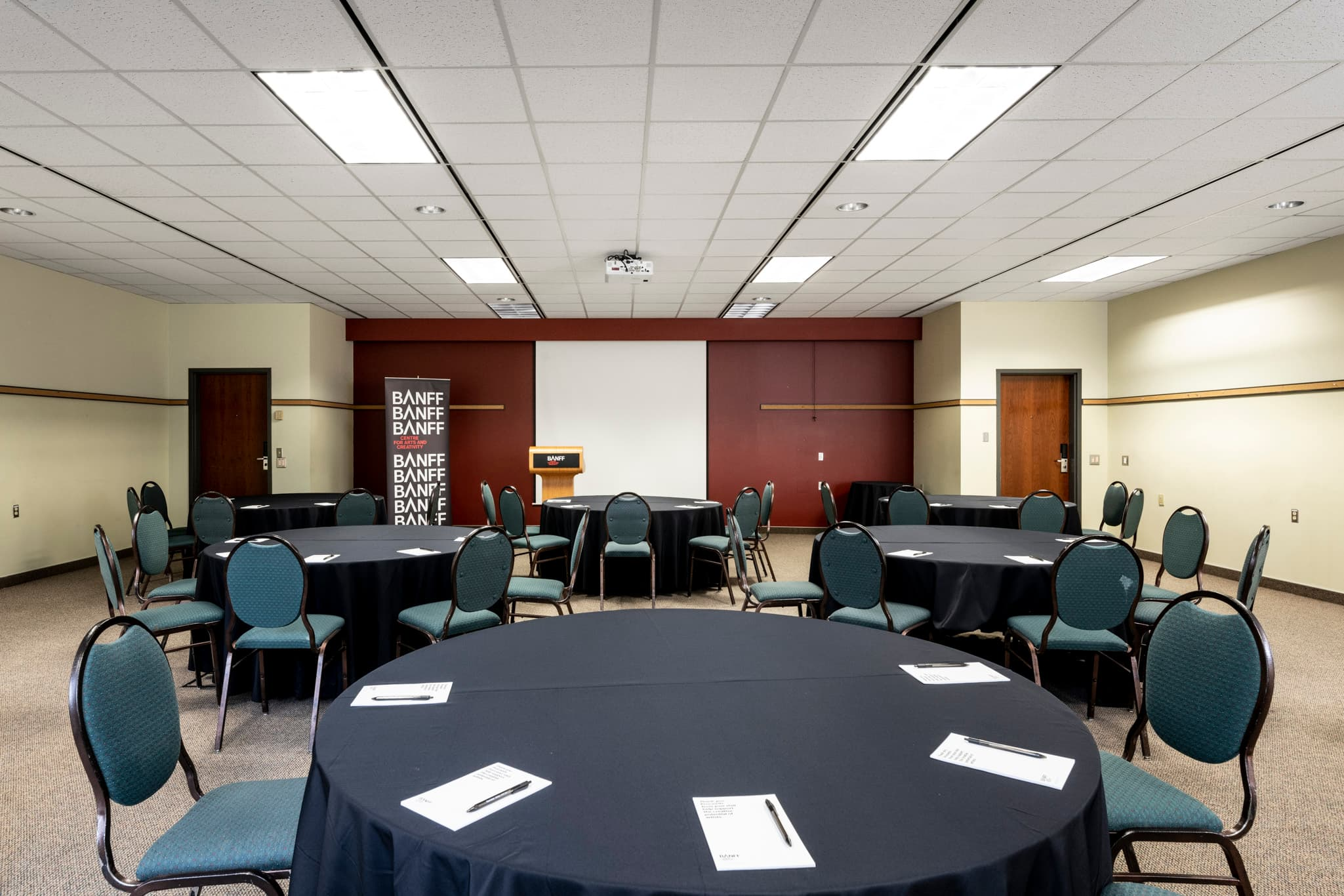 A conference space with round tables.