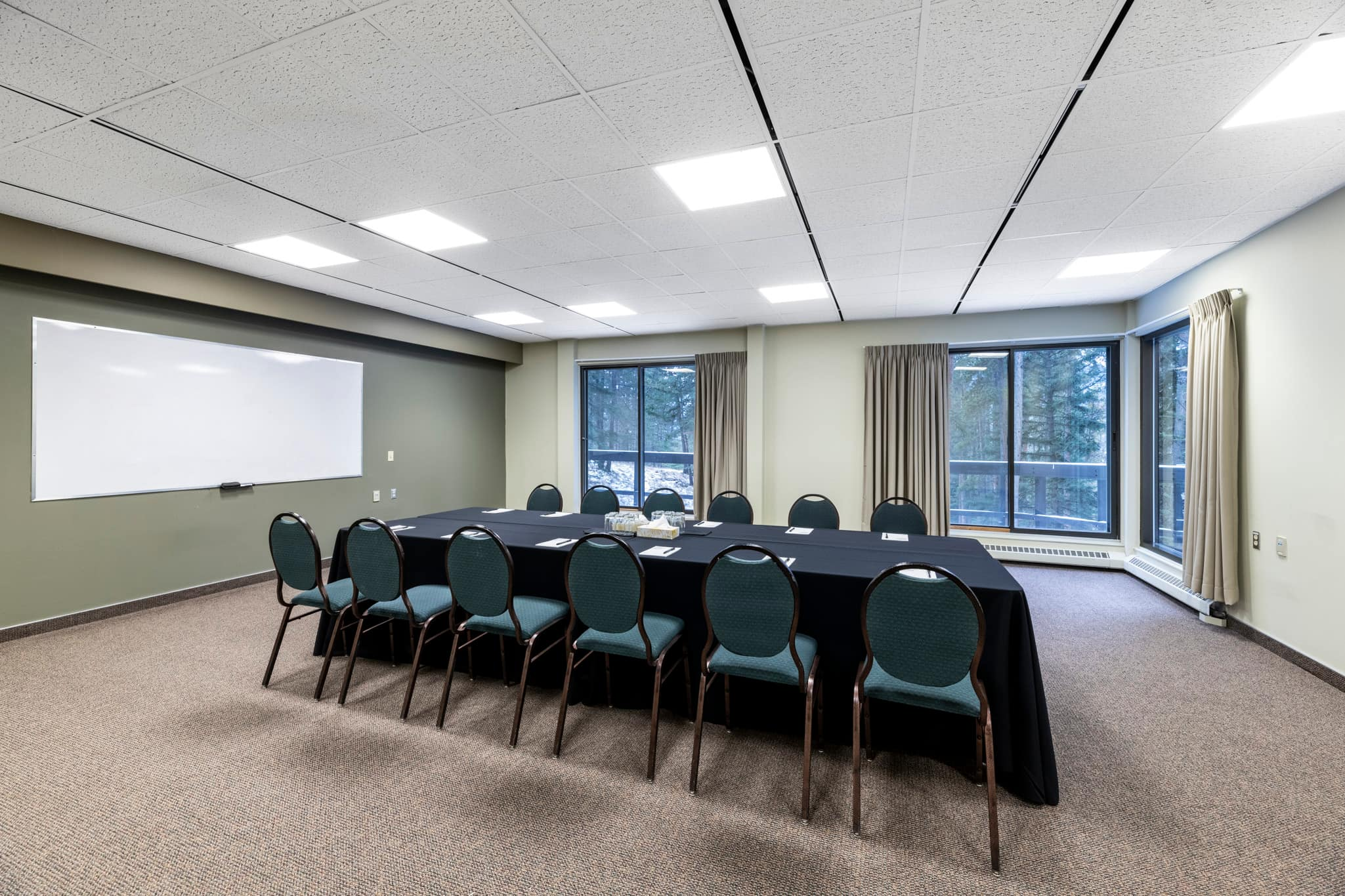 A conference space with boardroom setup.