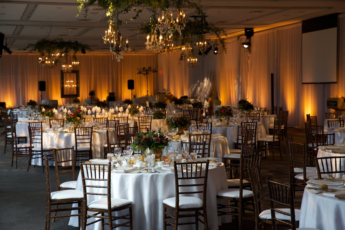 A room a beautiful setup for a wedding reception.