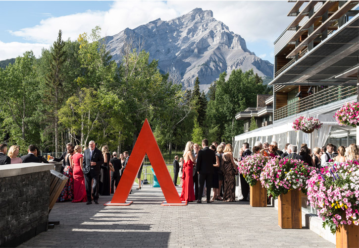 Guests socialize at Banff Centre in the summer.