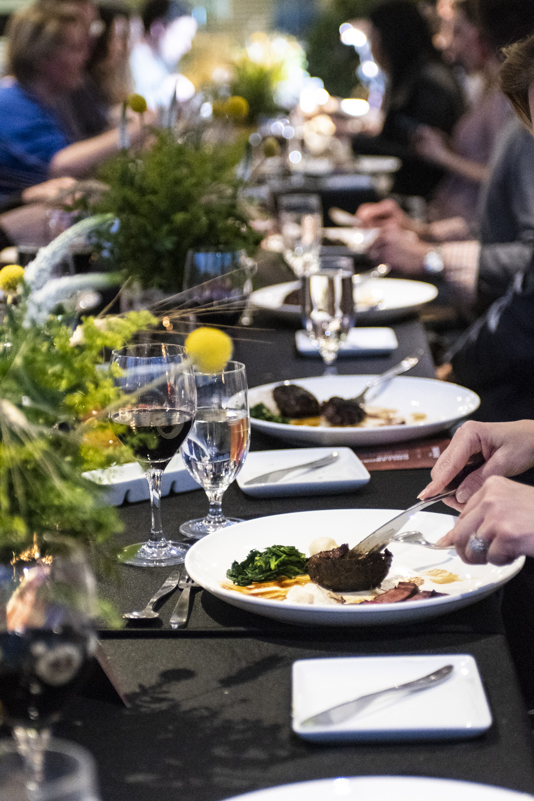 Guests enjoying Brant Lake Wagyu Beef Tongue and Cheeks during Collaborative Dinner with celebrity Chef Anita Lo.