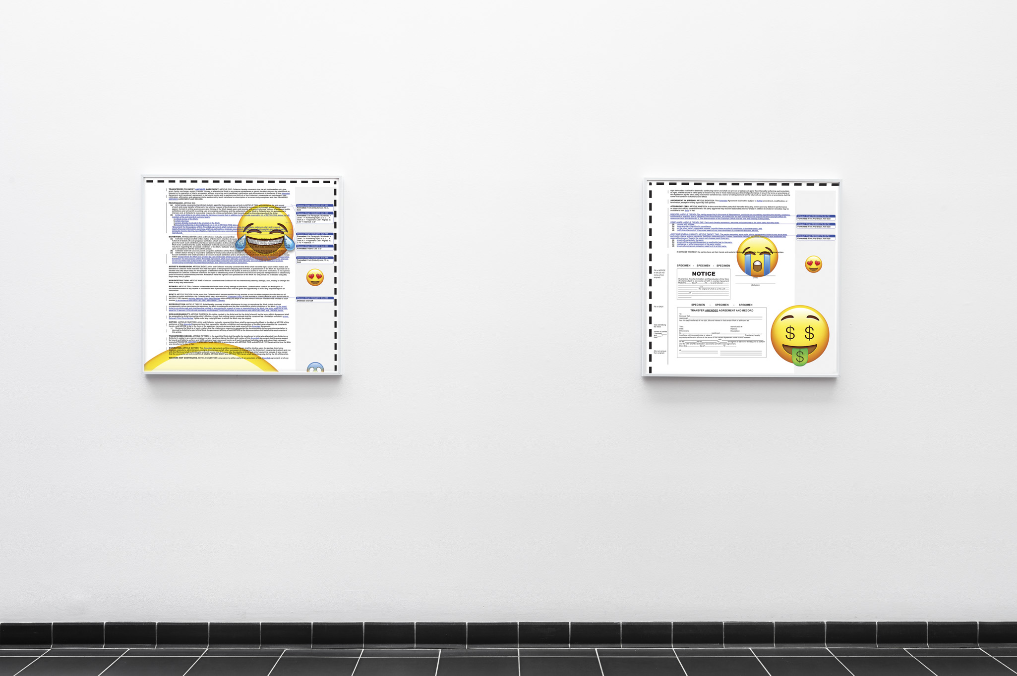 Two artworks line a hallway painted white. The artworks have white frames. The artworks feature a text document that shows edits, and a variety of emojis overlaying the text.