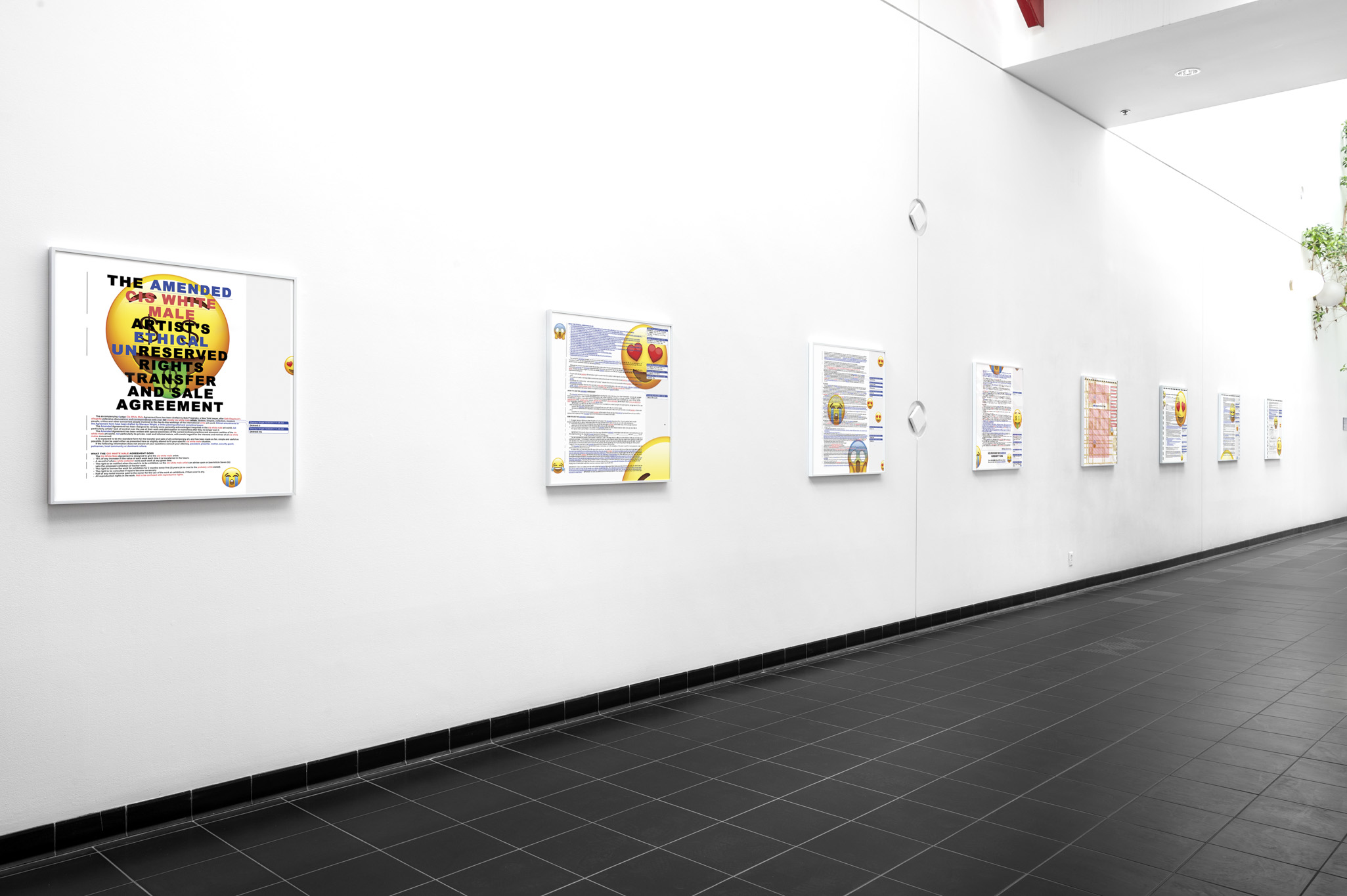 Eight artworks line a white hallway with black tile floors. The artworks are hung in white frames and each has a document inside it with a variety of emojis overlaid on top.