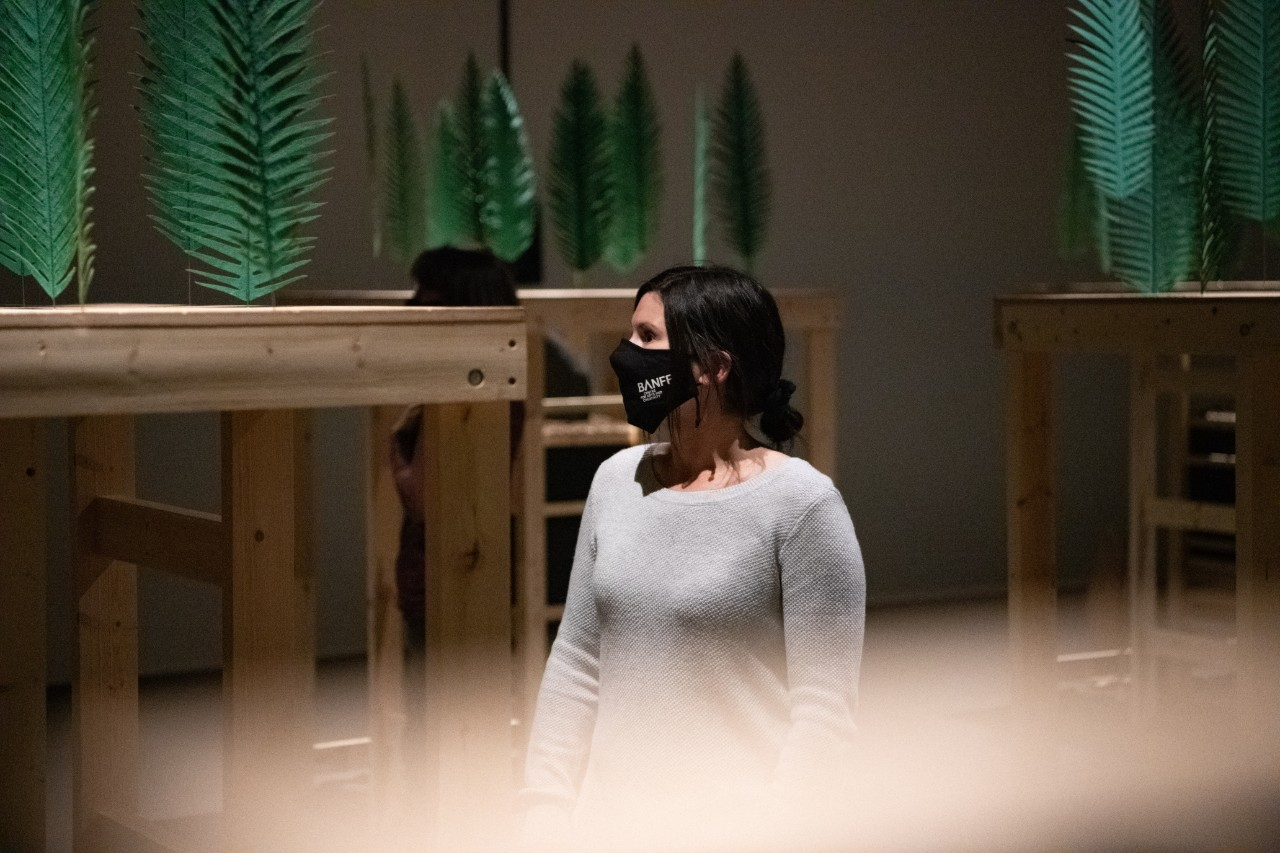 A gallery visitor is wearing a facemask.