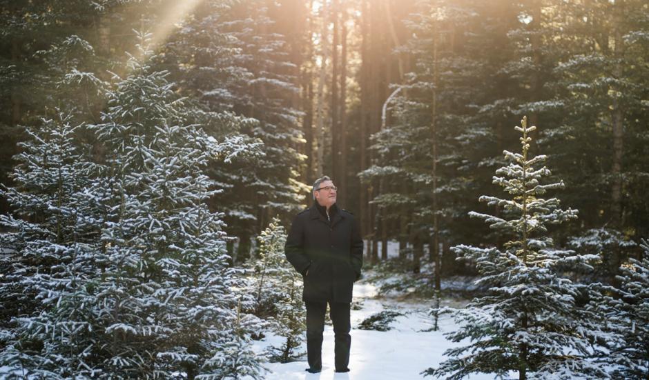 Brian Calliou looks up at Sleeping Buffalo Mountain in Banff, AB.