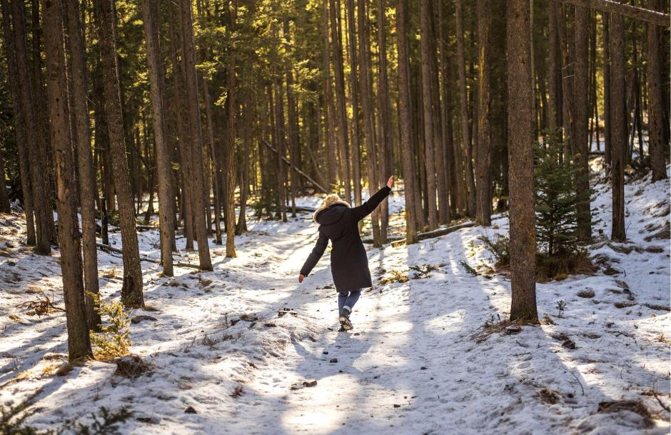 Crystal explores a forest trail.