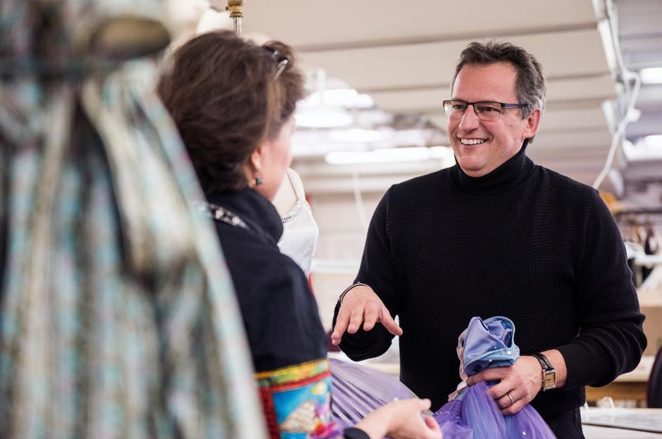 Jean Grand-Maître discusses costumes with designer.