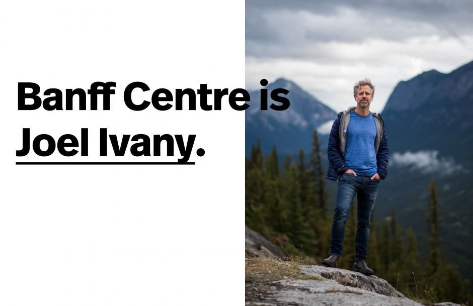 Image of Joel Ivany standing on top of a rock with a foggy mountain background.