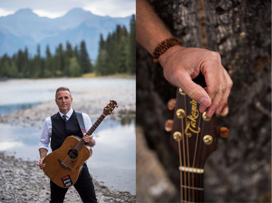 Sean McCann with his guitar alongside a river in the mountains.
