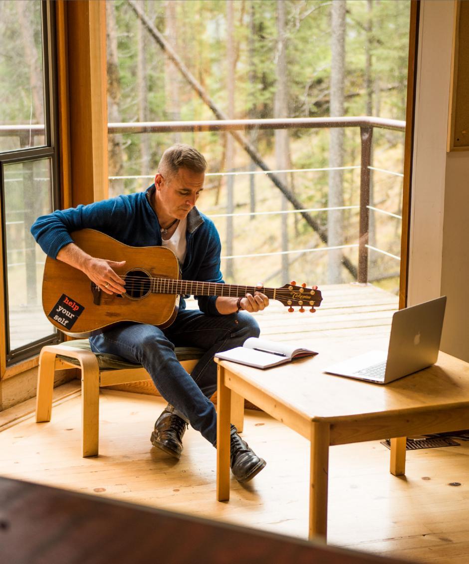 Sean McCann writing music in a studio.
