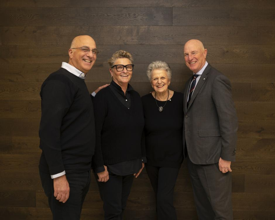 Photo of The Belzberg Family standing in front of a wall.