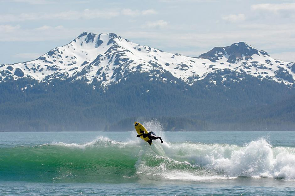 Chris Malloy catching waves off the coast of Alaska