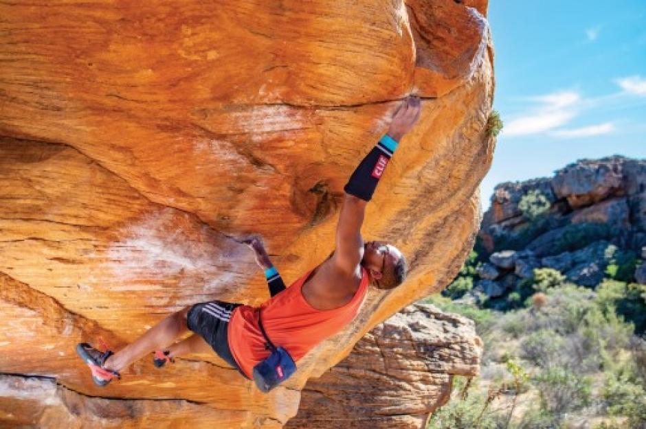 Kai Lightner bouldering in South Africa. Photo by Shane Messer