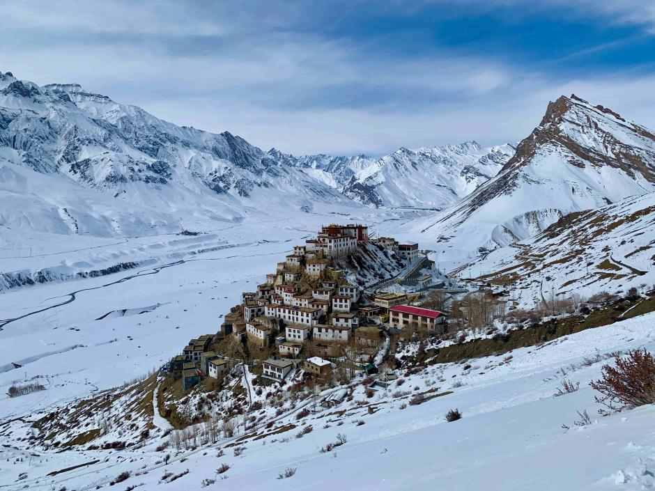A monastery in snowy mountains.
