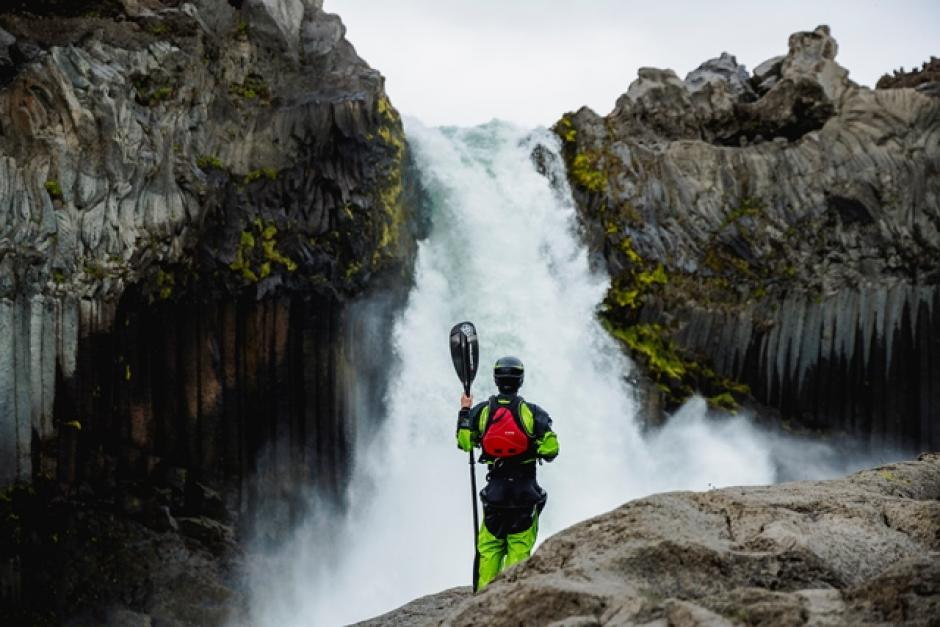 Image of kayaker in front of waterfall, from the film Why
