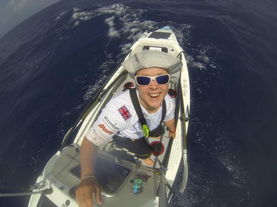Image of Sarah Outen rowing in the Pacific ocean