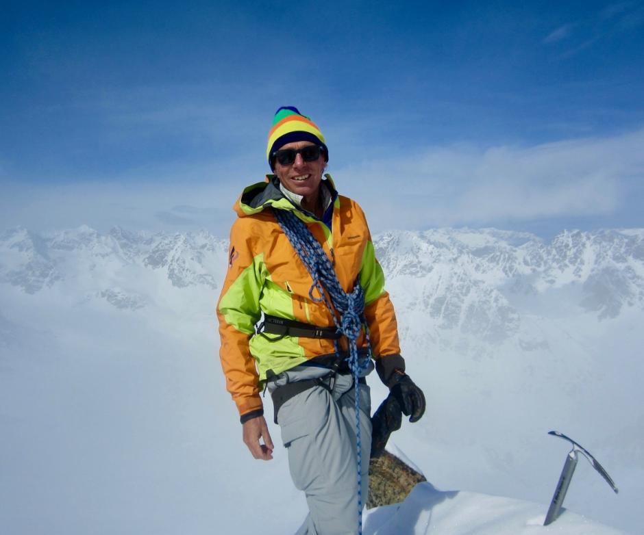 Larry Stanier on top of a mountain