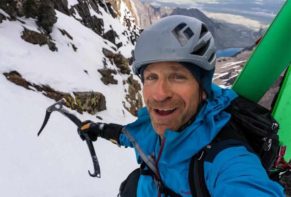 Photographer Christian Pondella takes a selfie as he climbs a mountain.