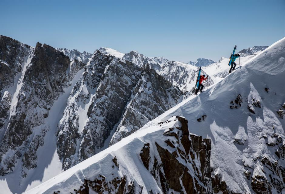 Two skiers climb into the Sierra Nevada backcountry for some ski touring.