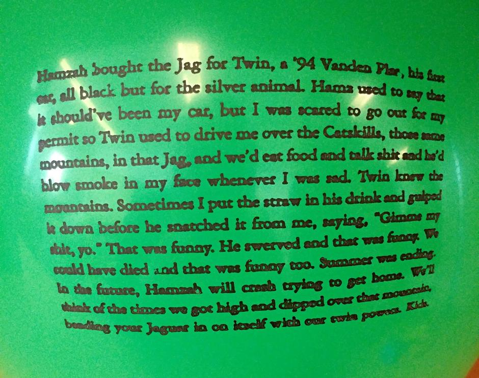 A green balloon with a short story printed on it.
