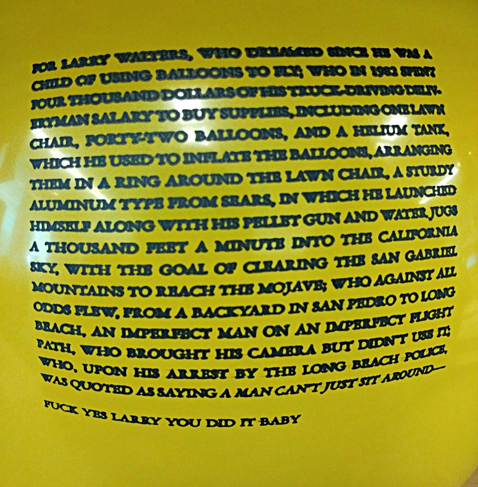 A yellow balloon inflated with a short story printed on it in all caps.