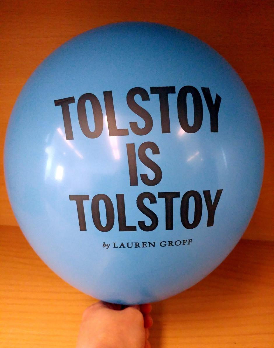 "A blue balloon inflated with the text, ""Tolstoy is Tolstoy by Lauren Groff,"" printed on it."