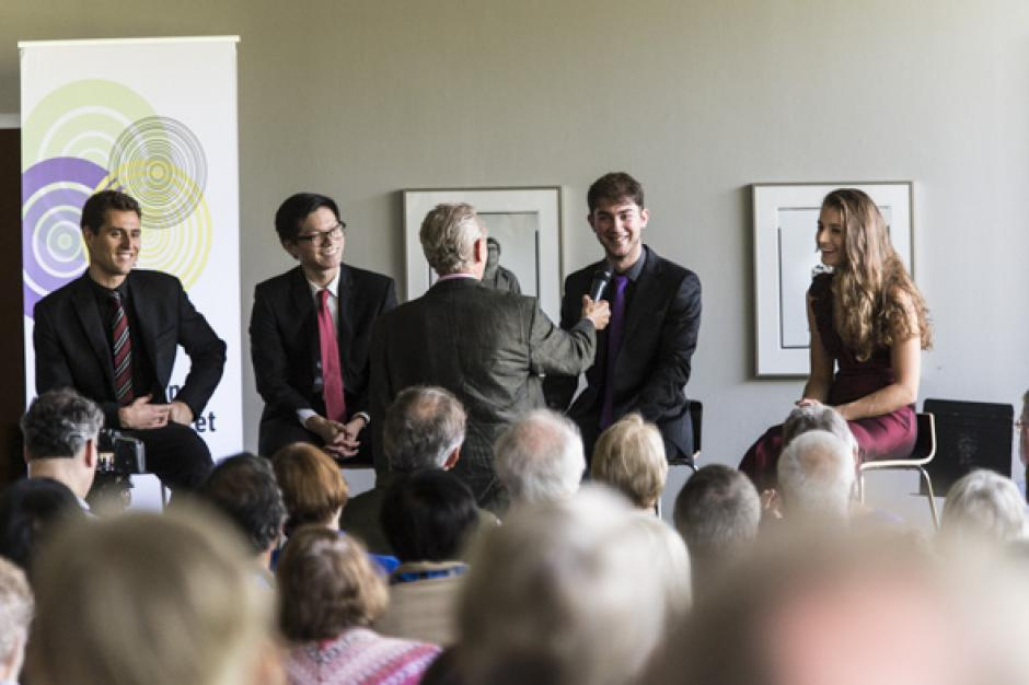 The Dover Quartet, (from left): Joel Link, Bryan Lee, Camden Shaw, and Milena Pajaro-van de Stadt, with broadcaster Eric Friesen.