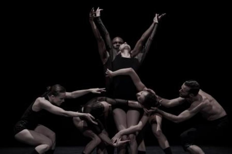 OCD Love in performance with dancers wearing black in a dark setting, performance/event coming to Banff Center. Banff National Park, Alberta.