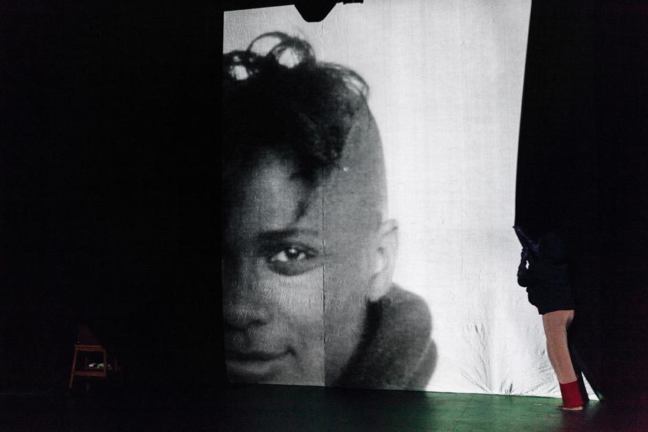 Shaded photo art shows artist Aisha Sasha John's face.