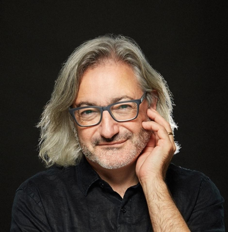 Headshot of author Gary Barwin wearing a black collared T in front of a black background.