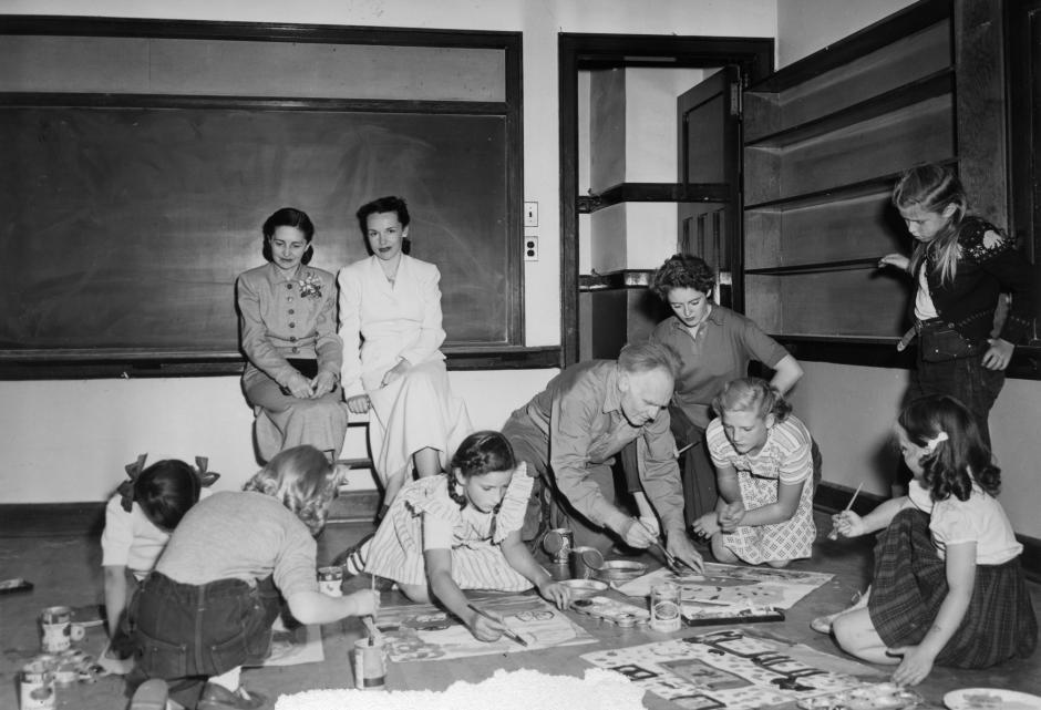 Art faculty Andre Bieler teaching a children's class indoors, 1952.
