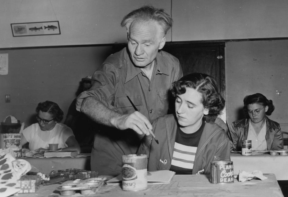 Art instructor Andre Bieler assisting a student, 1952, Banff Centre.
