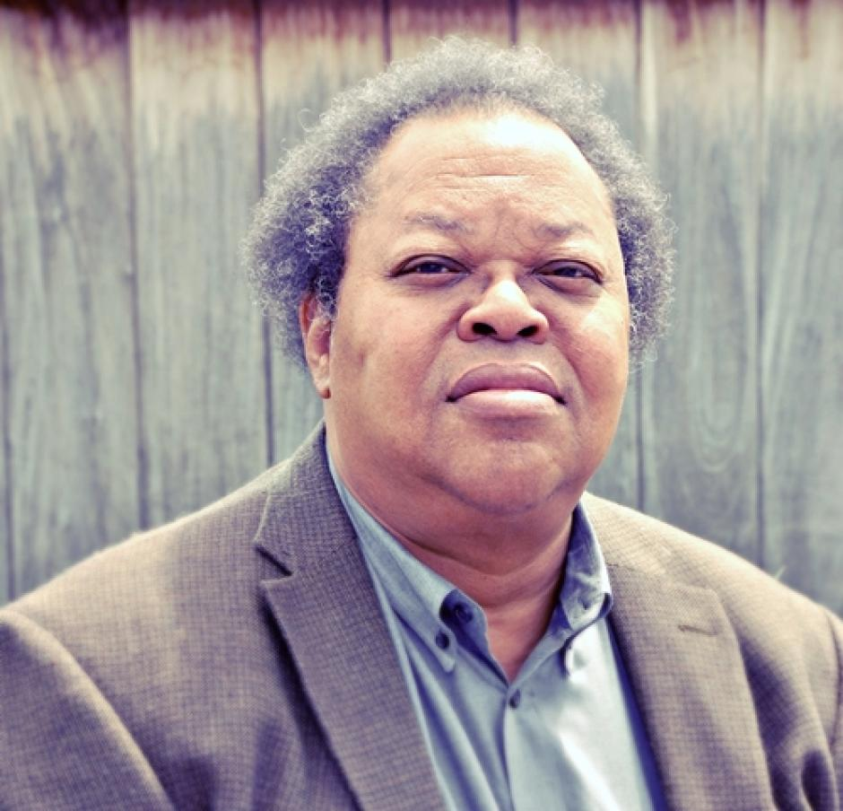 George Lewis in dress shirt and brown blazer, to perform at Banff Centre, Banff National Park, AB