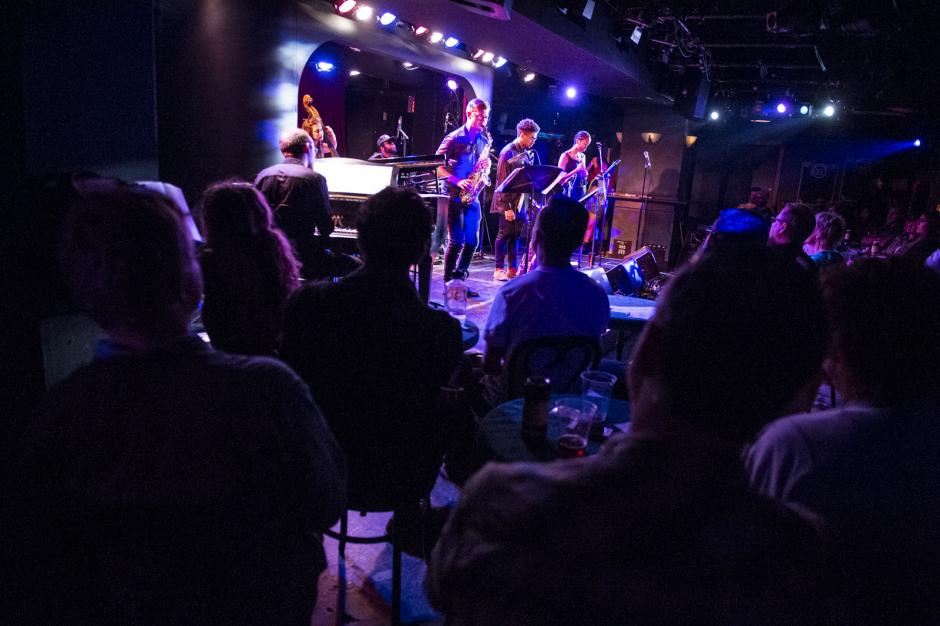 "A group of jazz musicians perform on a stage at Banff Centre's ""The Club"""