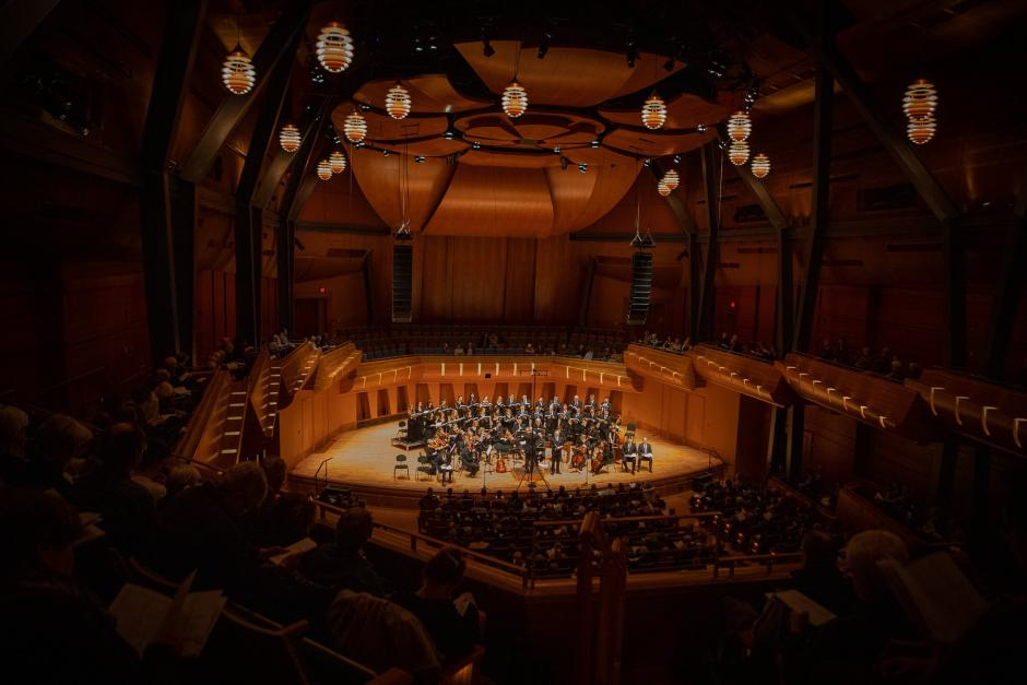 Luminous voices choir performs in a beautifully finished large dome shaped wood auditorium.