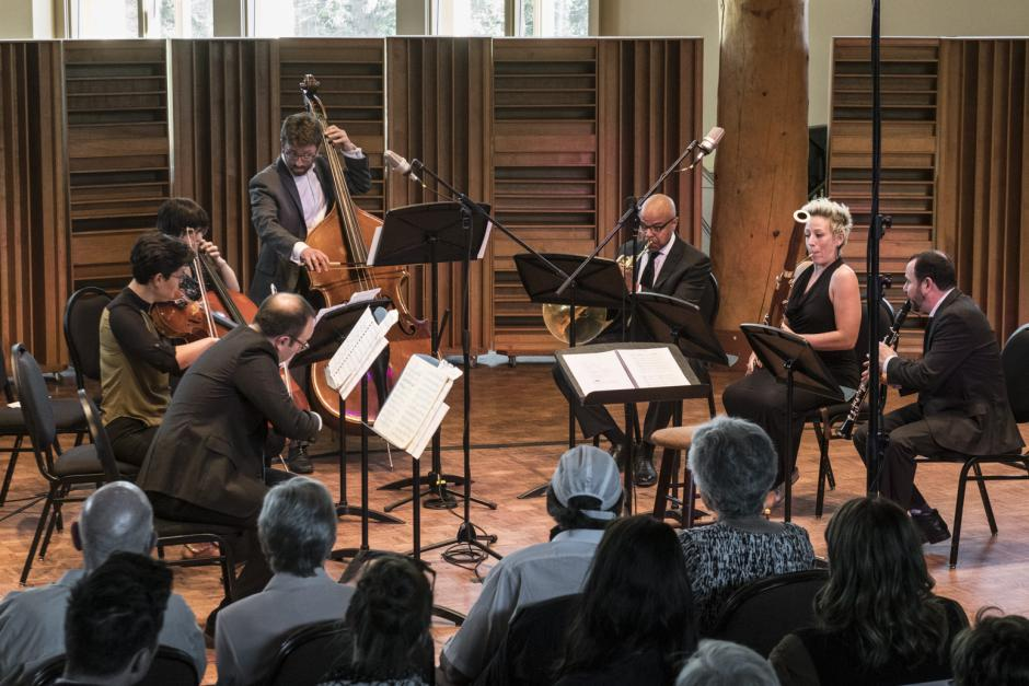 A well dressed music ensemble plays in Banff Centre's Rolston Recital Hall.
