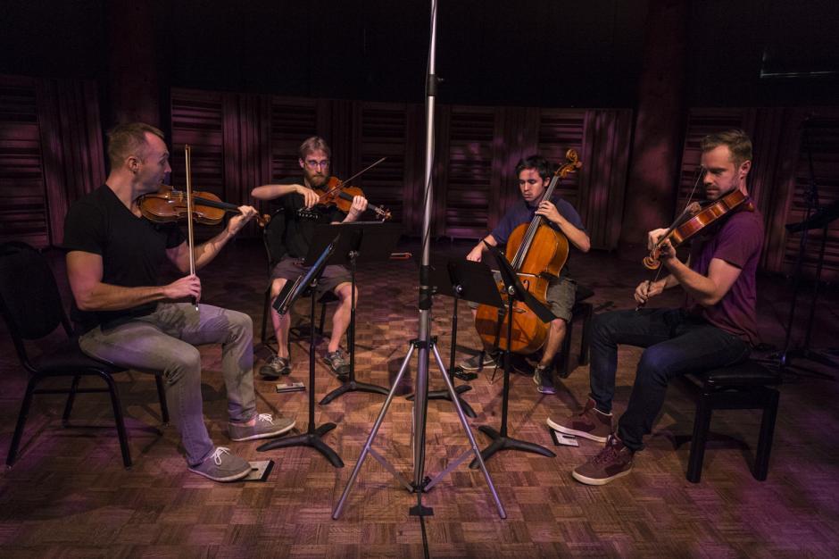The JACK Quartet performs in a small semi-circle at Banff Centre, Banff National Park, Alberta.