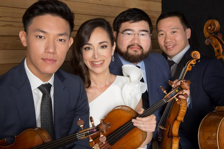 The Parker quartet holds their instruments grouped closely in formal wear.