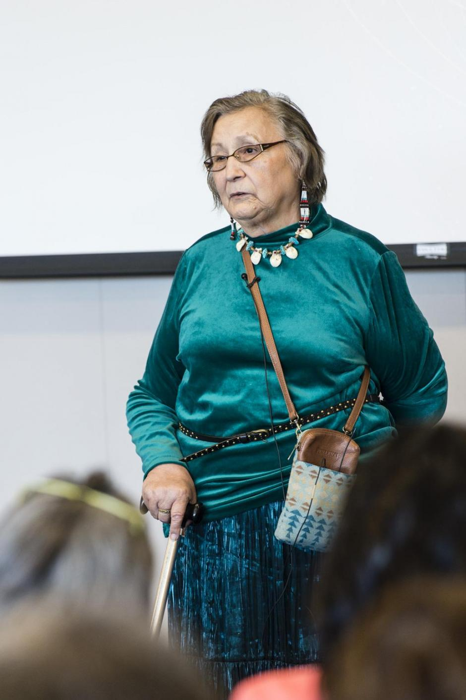 Elder Dila Houle delivers opening remarks at the Hope Decoded summit