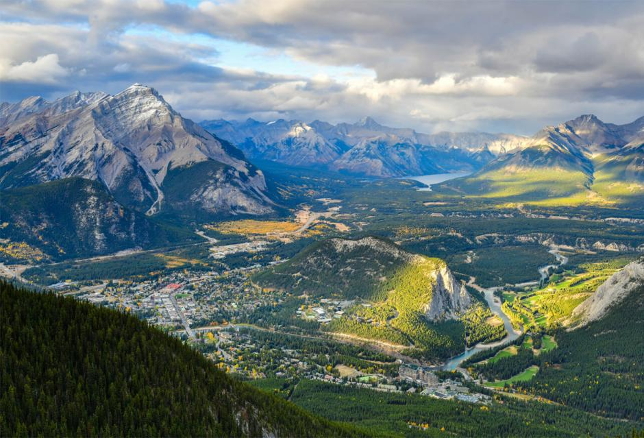 Aerial view of the town of banff in summer with green grass.