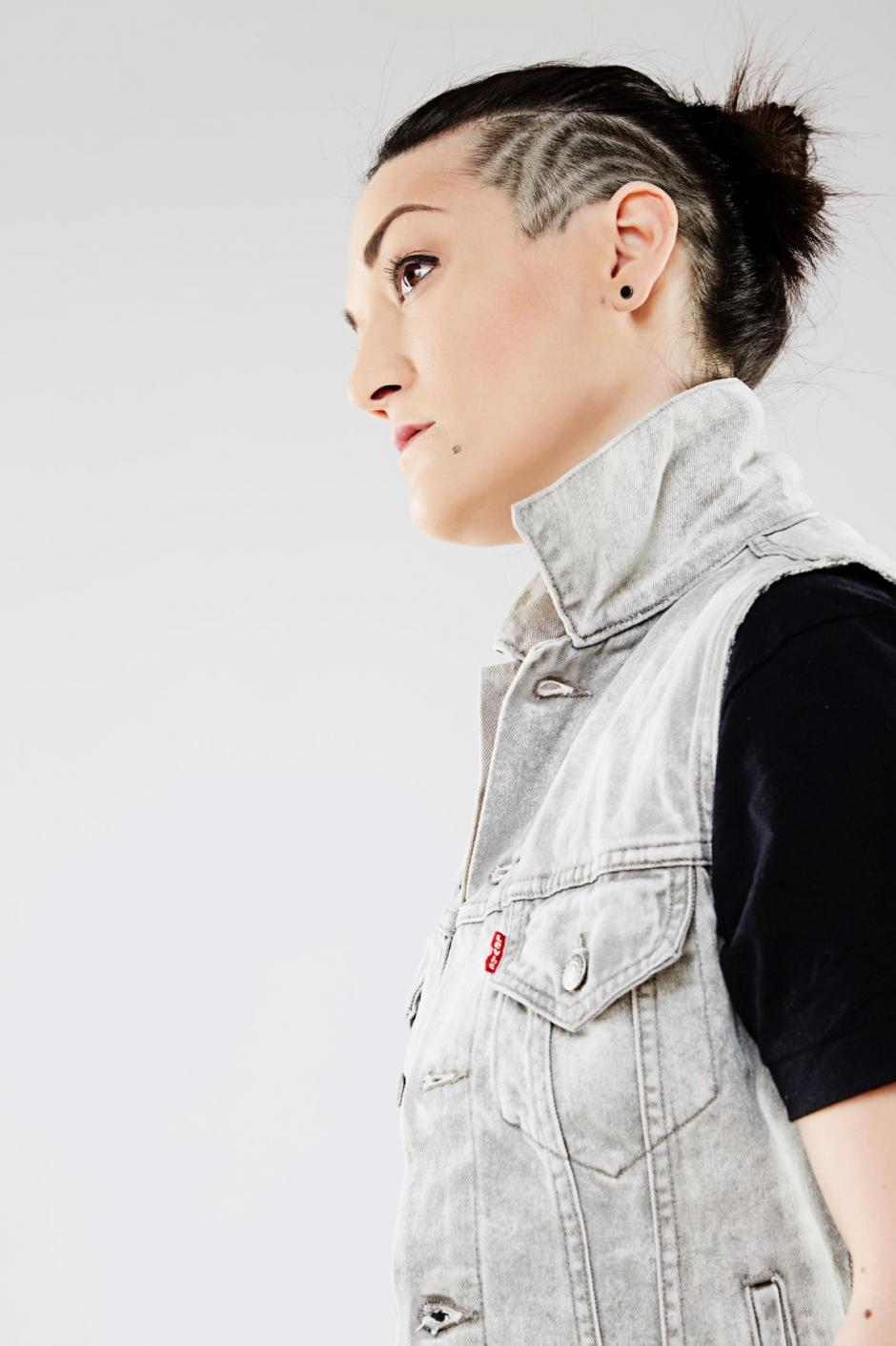 Photo of program faculty, Teija Kasahara, in side profile with head tilted away