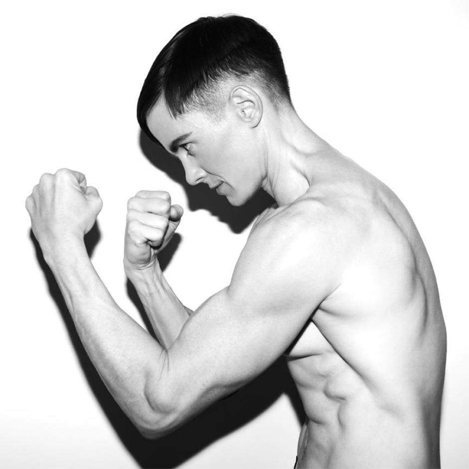 Photo of program faculty, Cassils, in profile boxer pose