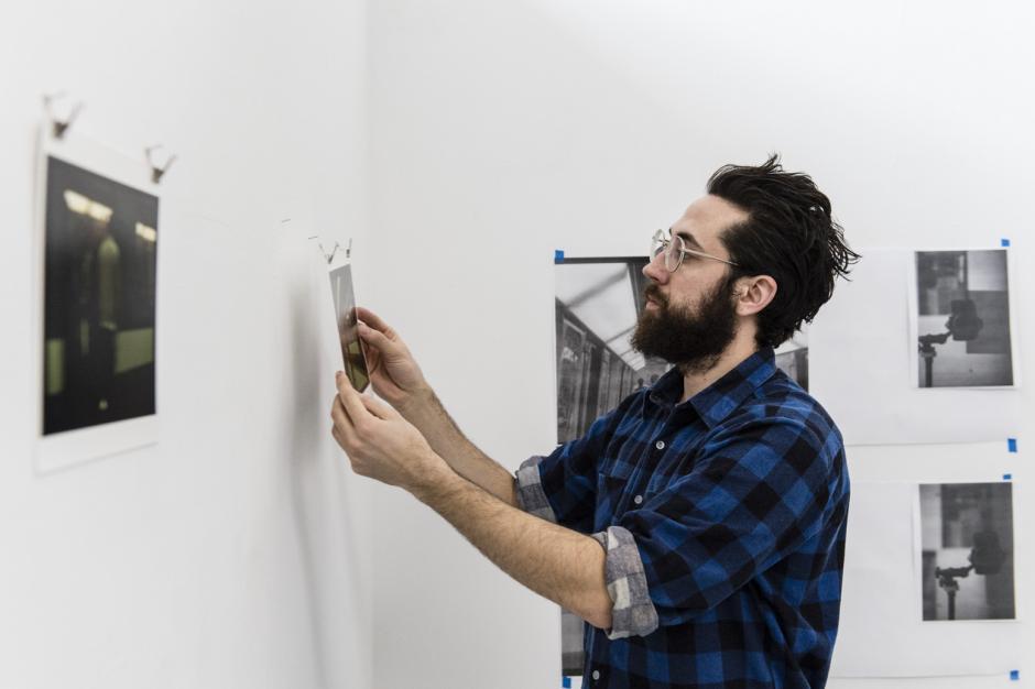 Artist Alexis Lagimodiere-Grise hangs work in his studio during the Winter BAiR 2018 residency.