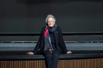 Banff Centre donor sits in an empty Eric Harvie Theatre.